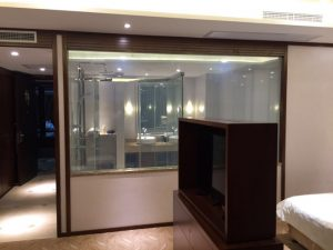 Switchable glass wall partition on